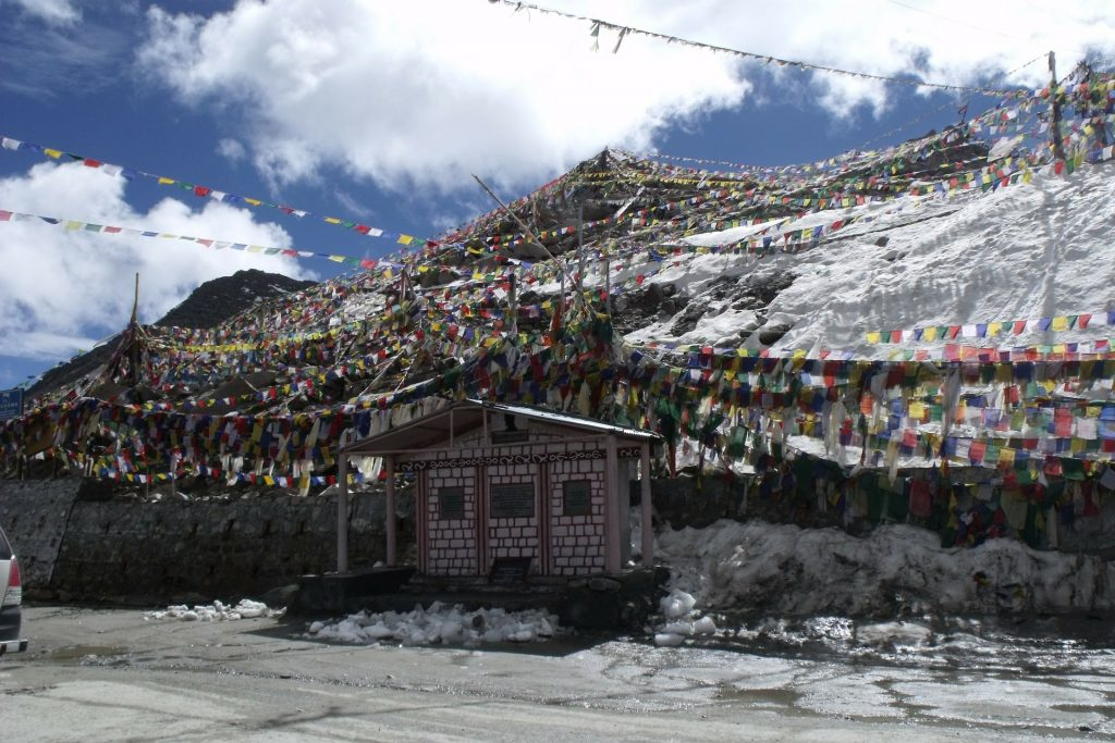a high mountain pass in Ladakh with Buddhist prayer flags