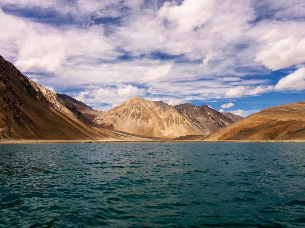 clear blue water of Pangong lake in Ladakh surrounded by beautiful mountains